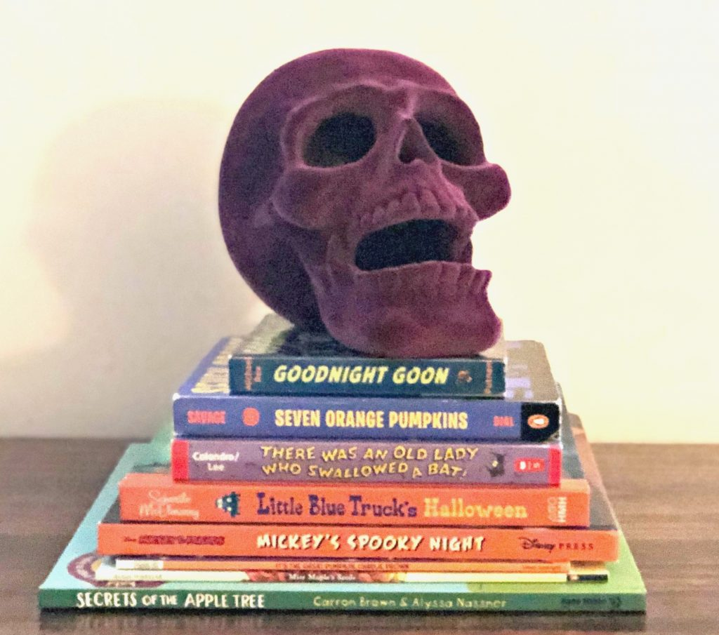 stack of halloween books to read in the fall