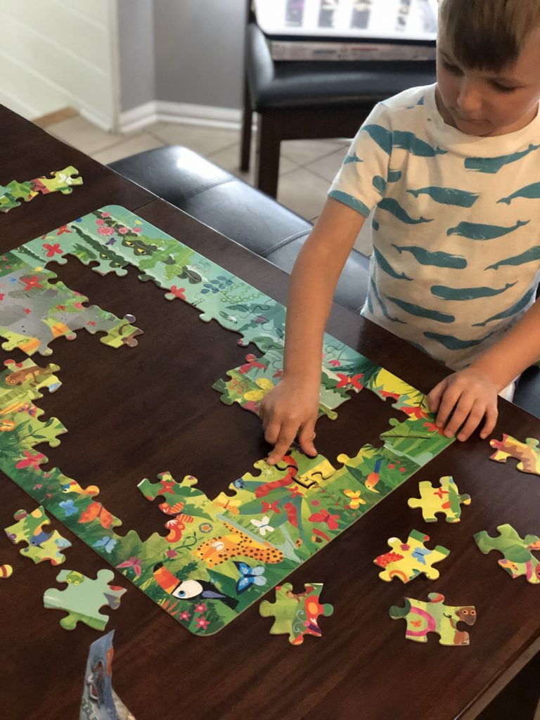 A child doing a puzzle