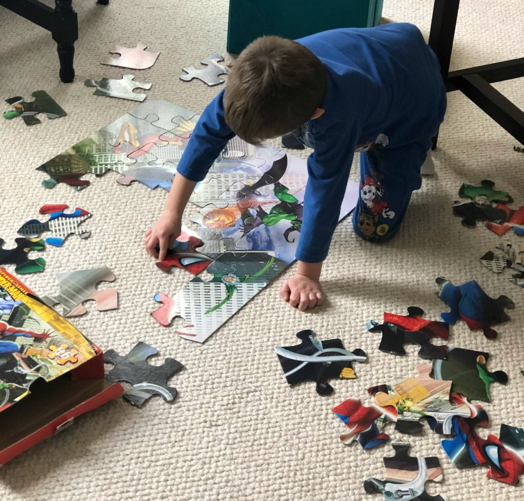 Boy doing puzzle as part of his afternoon routine.