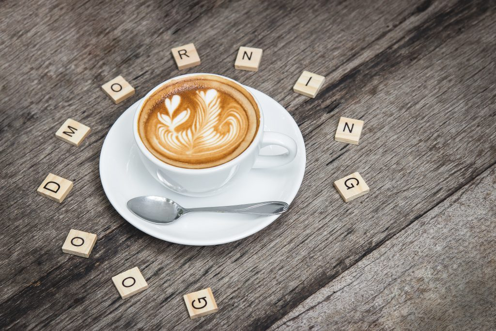 A cup of coffee as part of your morning routine with the words good morning around it