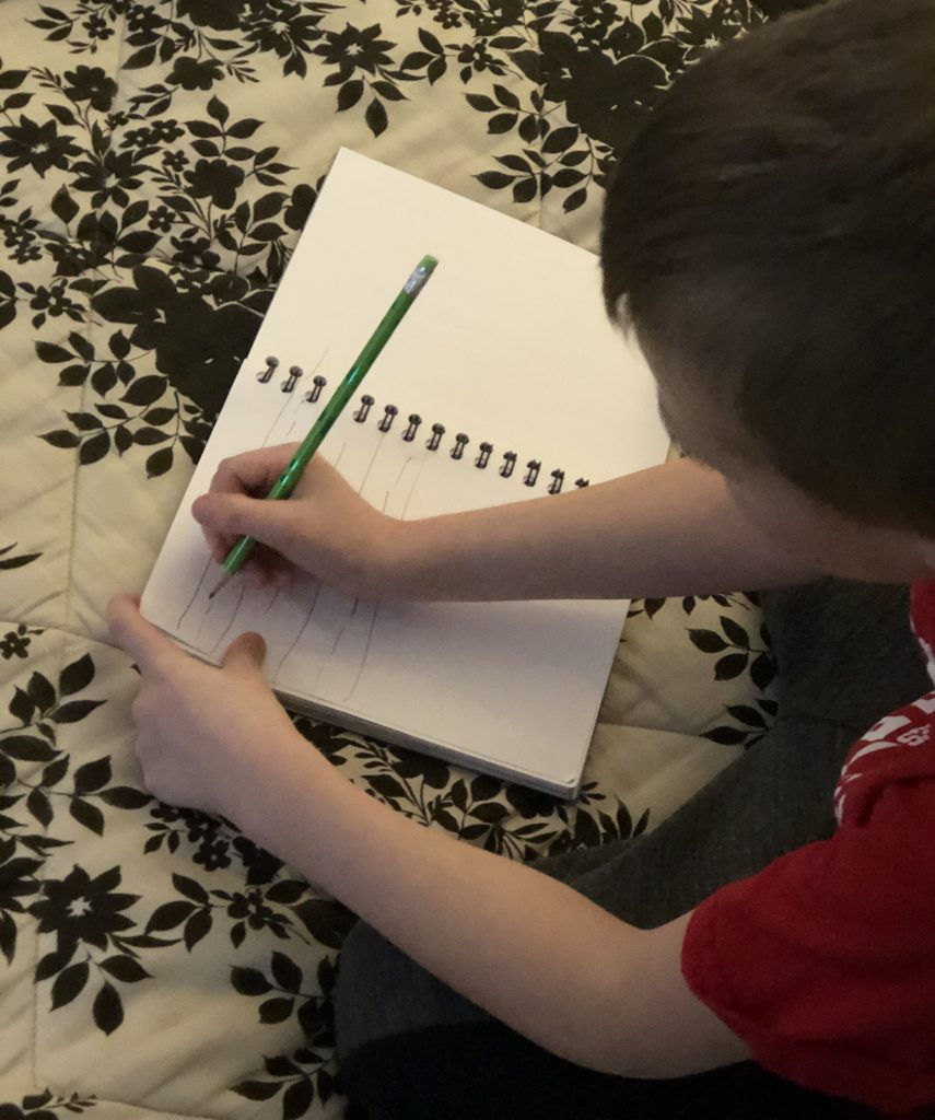 Boy doing his homework as part of the after school routine