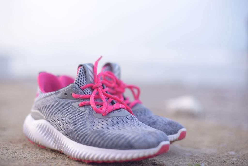 A pair of sneakers for walking as part of daily habits.
